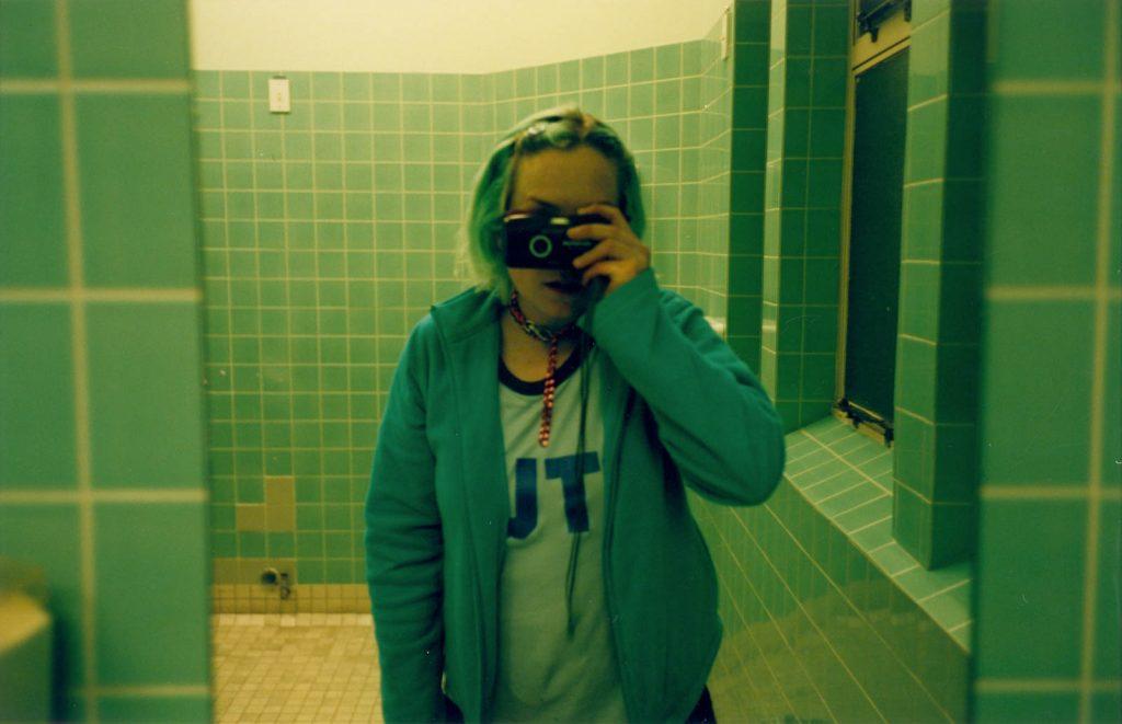 Daily Photo, 8 September 2001, Mint Stud, bathroom, camera, mirror, woman, portrait, photography
