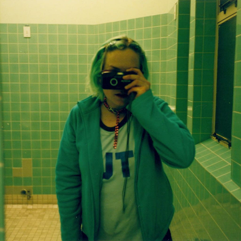Daily Photo, 8 September 2001, Mint Stud, bathroom, camera, mirror, woman, portrait, photography
