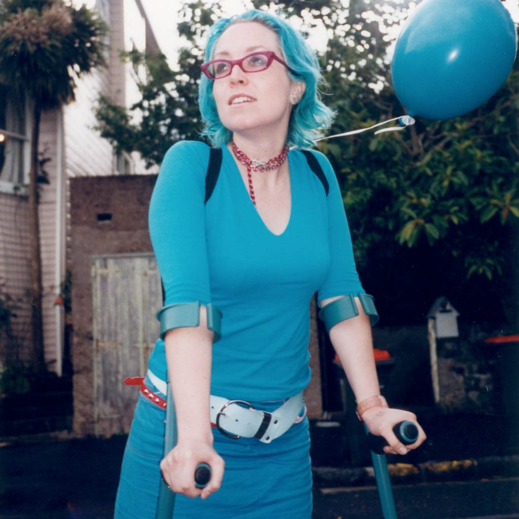 Daily Photo, 31 October 2001, Turquoise Balloon, crutches, matching, turquoise hair, turquoise clothes, woman, portrait, photography